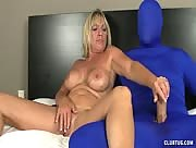 Mom Tweaks Her Twat and Handjobs Masked Man in Latex