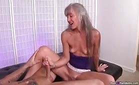Granny Exposes Pussy and Handjobs a Young Dude