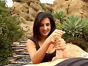 Latin babe gives handjob outdoors