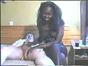 Interracial handjob on bed
