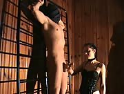 Mistress jerks off her masked sub tied to a rack