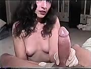 Cute girl gives handjob while wearing latex gloves