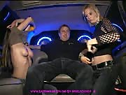 Two hot girls give a handjob in the back of a limo