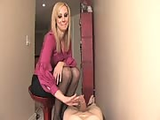 Hot blonde chick gives a handjob to a laying guy