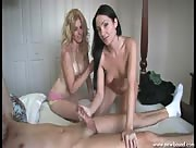 Two hot women slowly jerk off a lucky guy
