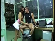 Dude gets jerked off all over his office by a cute girl