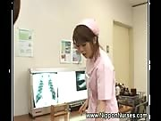 Asian Nurse Takes Care Of Her Patient