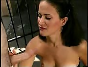 Latina sucks on lilipop whilst giving a handjob