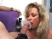 MILF Smokes While Giving Handjob with Gloves