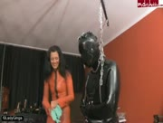 A Mummified Slave Receives A Gloved Handjob from a Smoking Lady Ginga Who Humiliates Him, Too