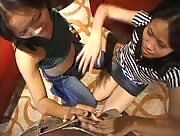 Two Filipinas Giving me a blowjob and handjob