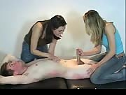 Three girls give tied down guy hand job