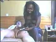 Interracial handjob on bed