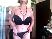 Chubby busty mature chick strips then jerks her man off