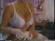 hot chick jerks off a dude in a body cast.