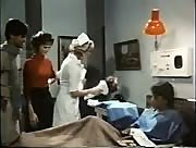Vintage porn shows off a lucky dude getting jerked off by a busty nurse.
