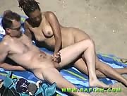 Black Slut Making Cocks Spurt At The Beach!