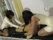 Ejaculation Of Strapped Man Being Milked By two Latex Women
